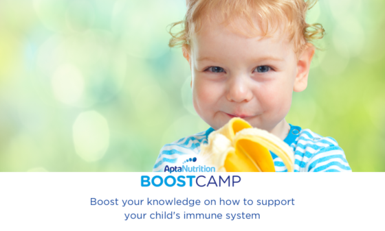 toddler with banana prebiotic help immune system aptamil boostcamp